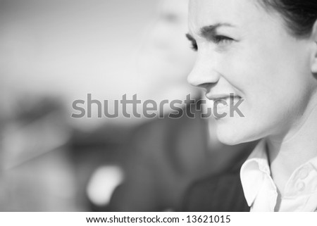 close up of businesspeople standing in a row looking in same direction - stock photo