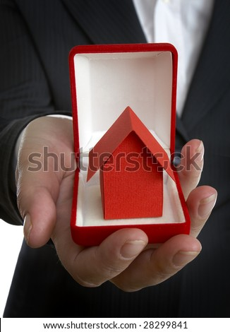 close up of businesswoman and miniature house in wedding rings box