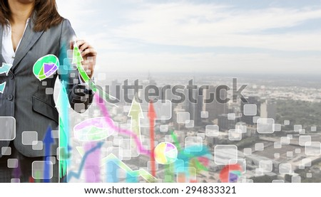 Close up of businesswoman drawing increasing graph with marker - stock photo