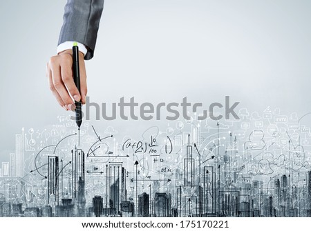 Close up of businesswoman hand drawing sketches with marker - stock photo