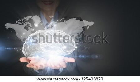 Close up of businesswoman holding brain concept in palms