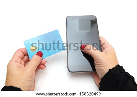 Close-up Of Businesswoman Paying With Credit Card On Mobile Phone - stock photo