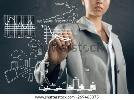 Close up of businesswoman sketching business project - stock photo