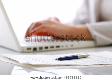 Close-up of businesswoman  typing documents on keyboard of laptop. selective view