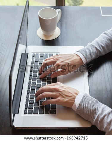 Close up of businesswoman using computer - stock photo