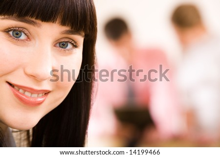 Close-up of businesswoman with smile on the background of people - stock photo