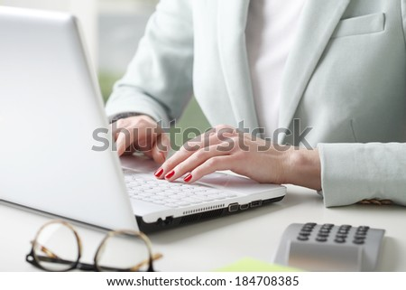 Close-up of businesswoman working on accountancy  with laptop. Small business.  - stock photo