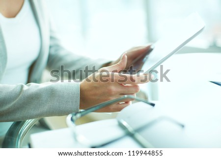 Close-up of businesswoman working with digital tablet - stock photo