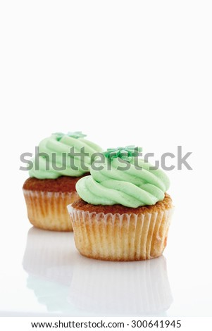 Close up of buttercream woodruff cupcake against white background