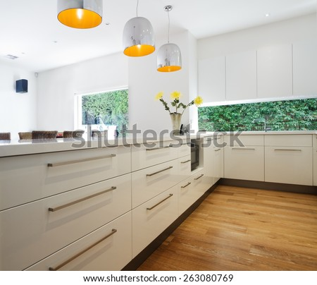 Close up of cabinetry drawers in a new contemporary white kitchen renovation - stock photo