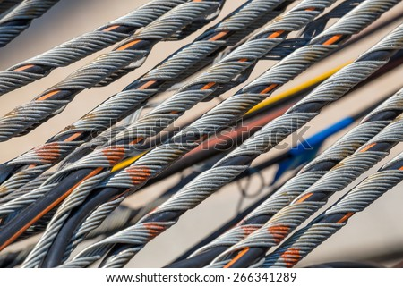 Close up of cables and wires on electricity post - stock photo