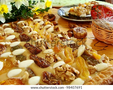 close up of cake with almonds, figs, apricots, nuts and with jonquils