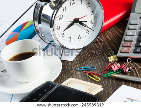 Close up of calculator documents and other staff on office table - stock photo