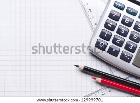 Close up of calculator, instrument of measurement and pencils - stock photo