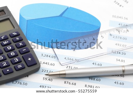 Close-up of calculator, pen and rule on paper table with graph. - stock photo