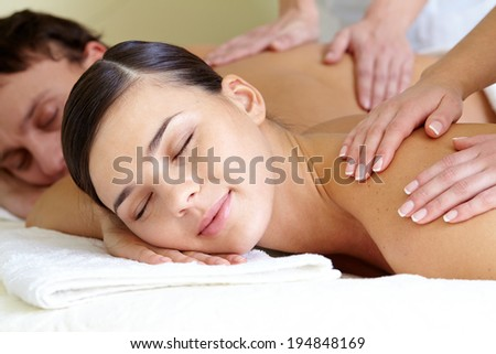 Close-up of calm female and male taking pleasure during massage - stock photo