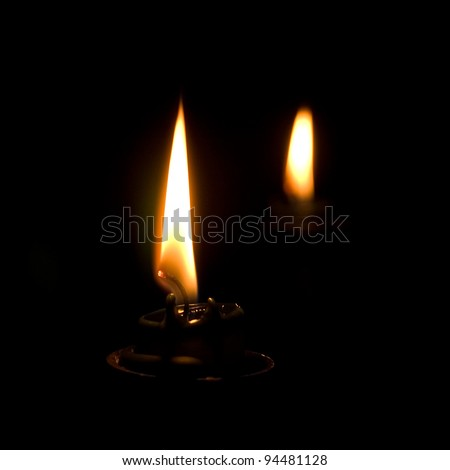 Close-up of candle flame in the dark. Copy space. - stock photo