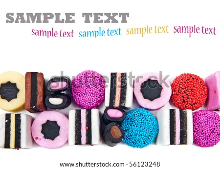 Close up of candy sweets and liquorice on a white background with space for text - stock photo
