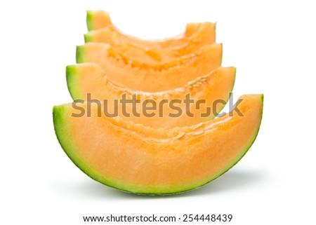 Close up of cantaloupe slices on white background - stock photo