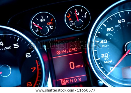 Close up of car dashboard on sports car - stock photo