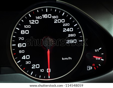 Close up of car dashboard with speedometer - stock photo