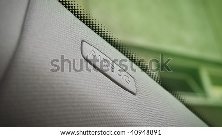 close up of car interior showing a side airbag location. - stock photo