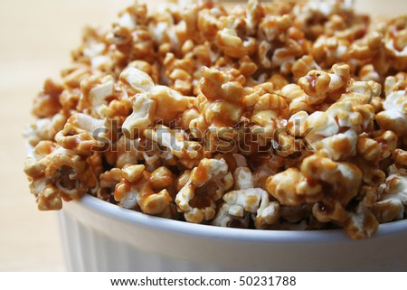 Close up of Caramel Popcorn in a White Bowl - stock photo