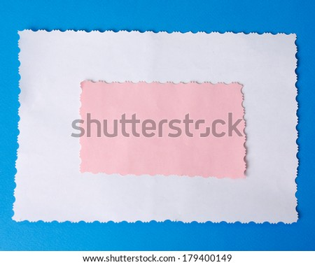 close up of card note with red ribbon on blue background with clipping path - stock photo