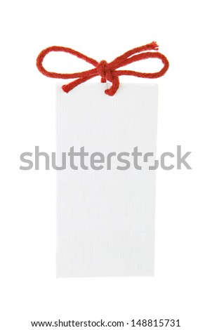close up of card note with red ribbon on white background - stock photo