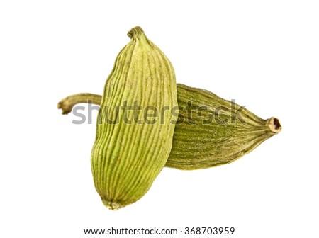Close up of cardamon pods on white background - stock photo