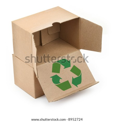 close-up of cardboard boxes with recyclable symbol against white background - stock photo