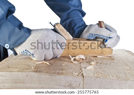 Close up of carpenter's hands working with the plane on white - stock photo