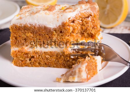 Close up of Carrot Cake on white plate. - stock photo