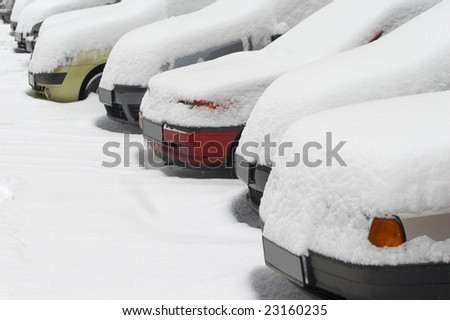 close up of cars in snow during winter - stock photo