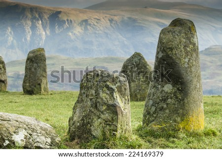 Close up of Castlerigg Neolithic Stone Circle situated in a valley beneath the mountain Helvellyn in the Lake District, Cumbria, England - stock photo