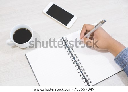 Close up of casual people business man sit drink coffee ,notepad and freelancer working on table and mobile smart phone with working or casual business concept  lifestyle.