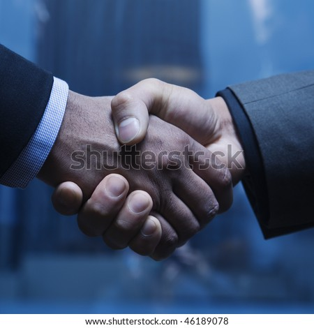 Close-up of Caucasian and African-American businessmen shaking hands. Square format.
