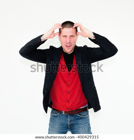 close up of caucasian angry businessman with hands in his hair isolated on white