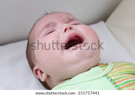 Close up of Caucasian baby girl crying face