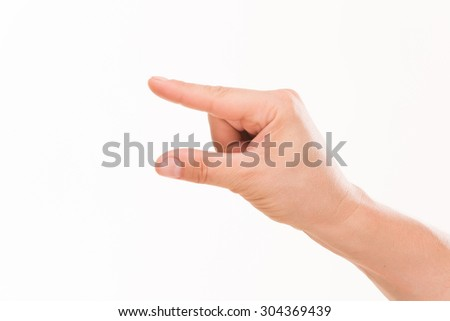 Close-up of caucasian man's hand holding stock of blank papers isolated on white background. The photo represented by point and thumb fingers.