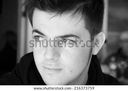 Close up of Caucasian teenage boy  - stock photo