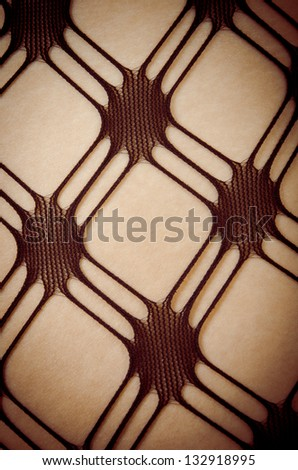Close up of Caucasian woman in pattern stockings (sexy female legs wearing lingerie) - stock photo