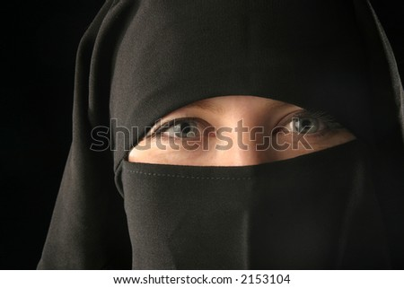 Close-up of caucasian woman wearing black veil.
