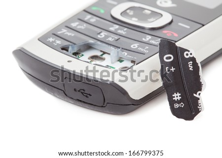 Close up of cell phone and sim card - stock photo