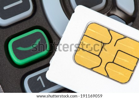 Close up of cellular phone and sim card  - stock photo