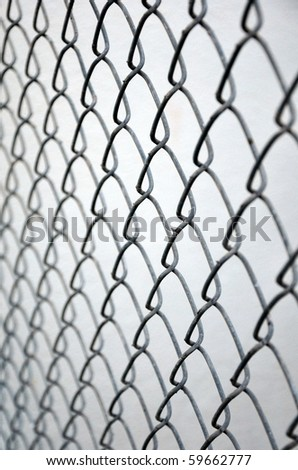 Close up of chain link fence. - stock photo