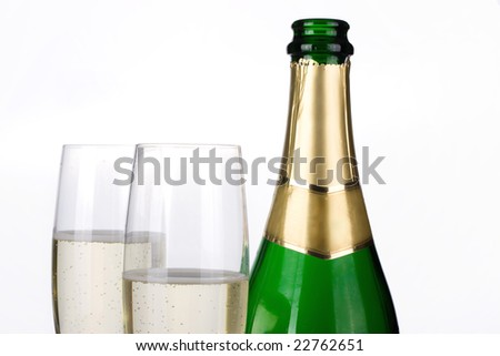 Close-up of Champagne bottle and glasses - stock photo