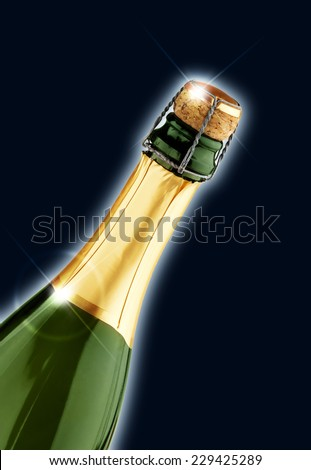 close up of champagne bottle isolated on black background - stock photo