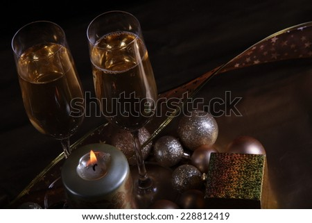 Close-up of champagne in glasses and candle. - stock photo