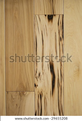 Close up of character grade hickory hardwood flooring planks. - stock photo
